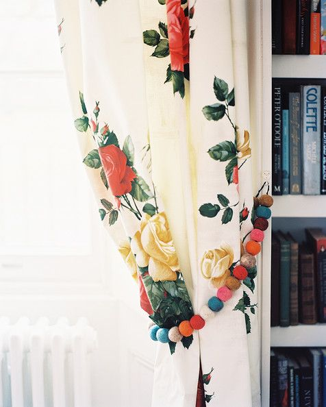 August September 2010 Issue Photo - Floral curtains with beaded tie-backs beside a white bookcase