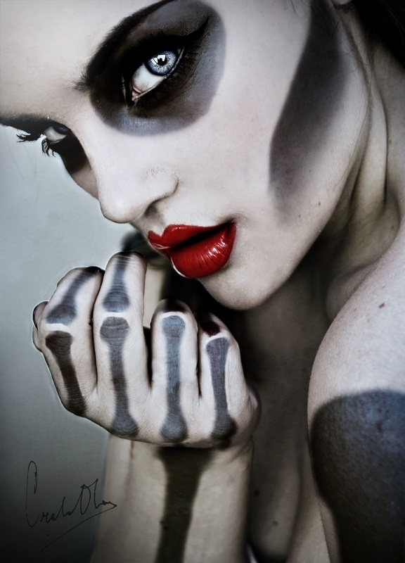 Skeleton makeup. Simple, kind of glam skull makeup. The bright red lips look awesome with it.