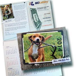 """Show Me Your Pets, Missouri Lottery Calendar 2014     Keep track of important dates and deadlines with a beautiful 2014 Missouri Lottery """"pets"""" calendar. Each month includes a four-color photo of an adorable Missouri pet – dogs, cats, rabbits and even raccoons and chickens! Special dates in Missouri Lottery history are also highlighted on the calendar dates. Calendar size is approximately 9"""" X 12""""."""