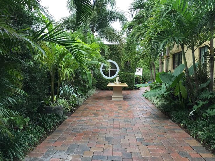 Entire home/apt in West Palm Beach, US. A lovely cabana with bed & living area, french doors opening onto the heated pool, private half bath & hot/cold outside rain shower under tropical plants and orchids and beautiful tropical garden area for dining. The entire area is enclosed by ta...