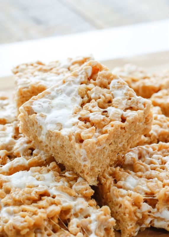 "Peanut Butter Marshmallow Crunch Bars are chewy, slightly crunchy, peanut butter bars are filled with pockets of gooey marshmallows. These easy treats were voted ""MORE than two thumbs up"" by all of my..."