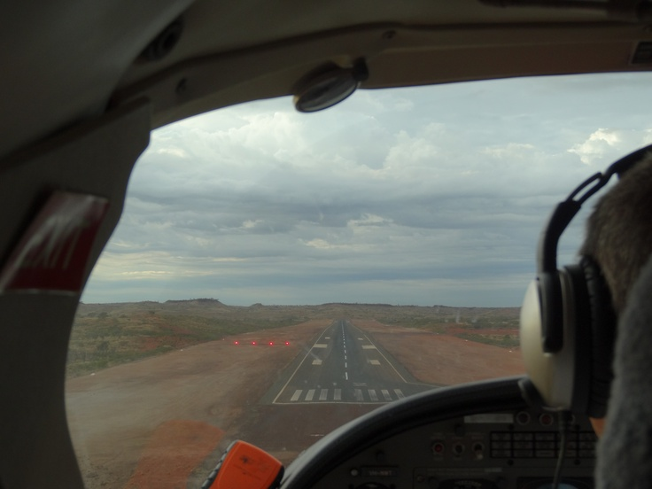 This is the airport for one of the iron ore mine sites in north west Australia. Being onboard a  tiny prop plane meant I could get a pilots view of the landing. There was no in flight service, or movie but that didn't matter. The Pilbara landscape is covered in rich red soil and the parched ground was interwoven with dirt tracks from prospectors searching for minerals in the wild landscape.