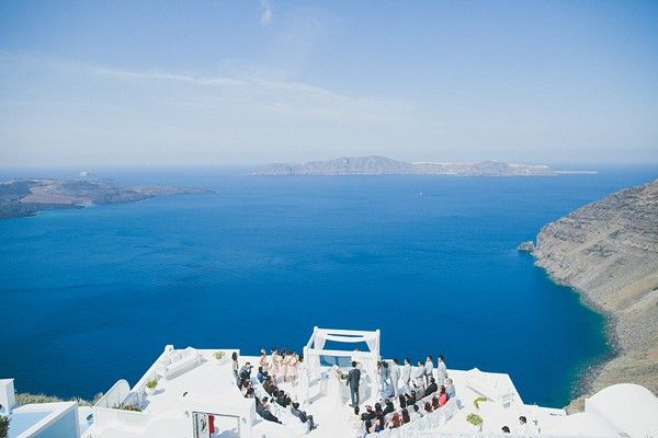 The #ceremony was held on a the edge of the cliff in a spectacular venue overlooking the volcanic #islands and #Aegean sea.