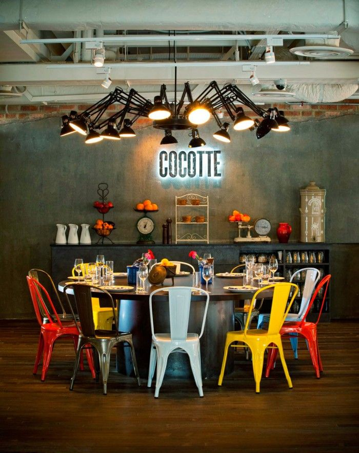 So urban industrial eclectic cool! Lovin' the color combo on the metal chairs! Fabulous decor find via @DwellStudio