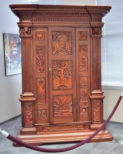 The Wardrobe from Chronicles of Narnia, would love this in my house!- and if you're familiar with The Magicians Nephew you will see that story told on the wardrobe itself