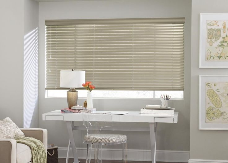 """This tucked away transitional office space feature our 2"""" Macro aluminum blinds. These custom window treatments from Hunter Douglas offer a dramatic design option for larger windows with a wider view-through."""