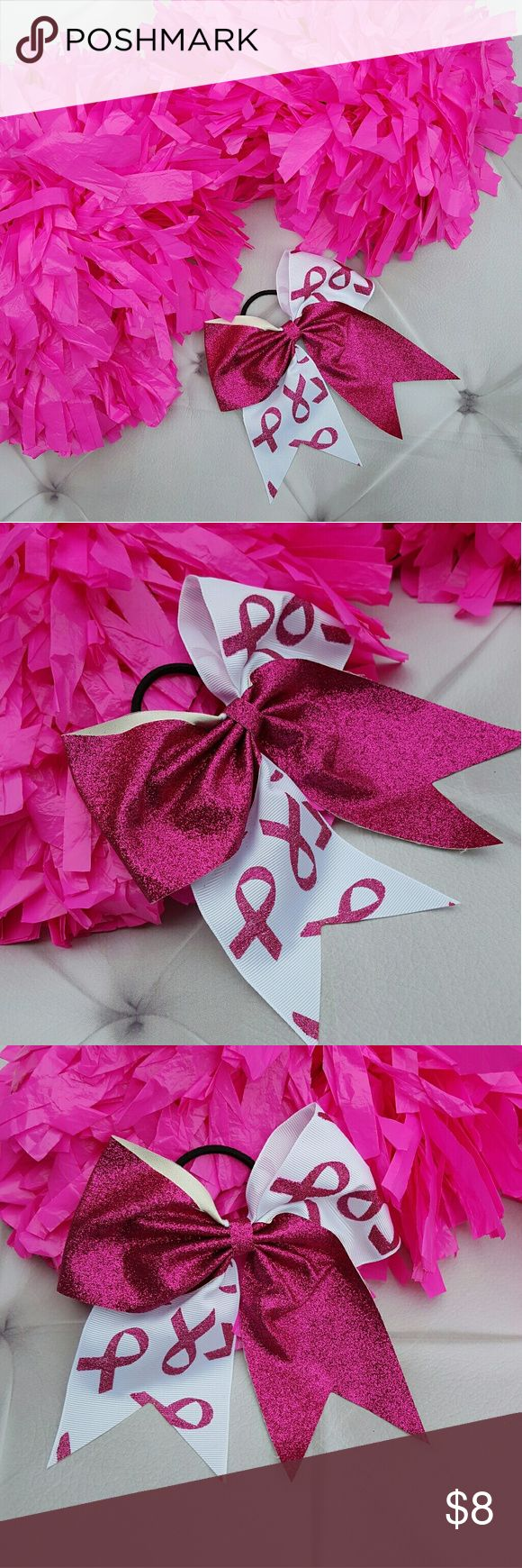 "Glitter Pink Breast Cancer Awareness Cheer Bow Think pink !Glittered new breast cancer awareness symbol print large cheer hairbow. On   black elastic ponytail holder. New never worn.  Measurements : 8""height 6""across front  #ravenkittystyle #cheer #cheerleader #breastcancerawareness #cure #pinkribbon #glitter #bow #hairbow #cheerbow #bigbow #pink #hotpink #whiteandpink #cheeruniform #october Accessories Hair Accessories"
