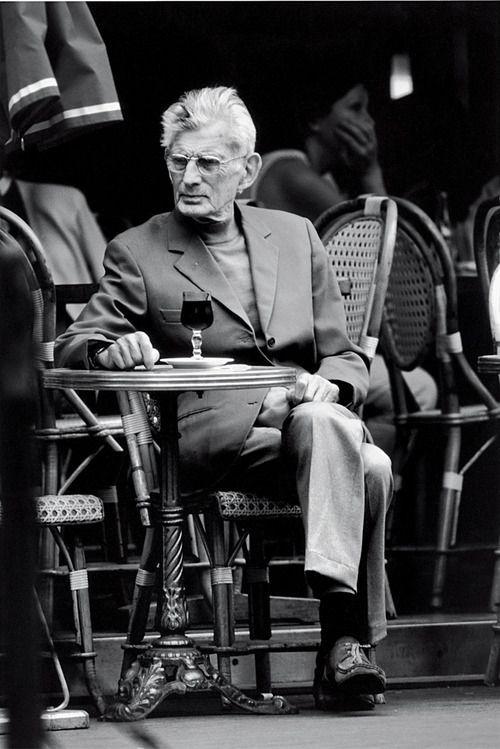 Samuel Beckett outside a Parisian café (via La Petite École / Pinterest)