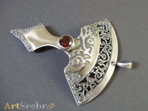 silver pendant with garnet
