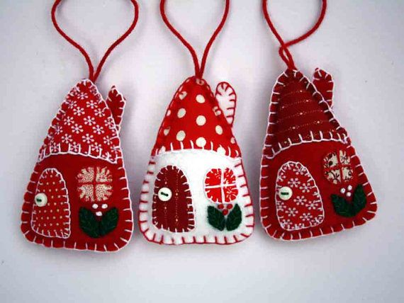 Red and white felt Christmas ornaments.  Set of three little hanging houses, handmade with felt and vintage cottons in red and white. The roofs, doors and windows are hand- appliqued with vintage cotton fabrics, embroidered berries grow on the walls, and the door knobs are tiny buttons.  Approx 8cm / 3 inches high.  The listing is for 3 houses. You can see more felt house ornaments here; https://www.etsy.com/ie/shop/PuffinPatchwork?ref=hdr_shop_menu&section_id=19324390