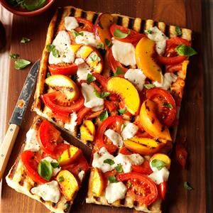 Grilled Tomato-Peach Pizza Recipe -This delicious pizza is unique, healthy and easy to make. The fresh flavors make it a perfect appetizer for a summer party. —Scarlett Elrod, Newnan, Georgia