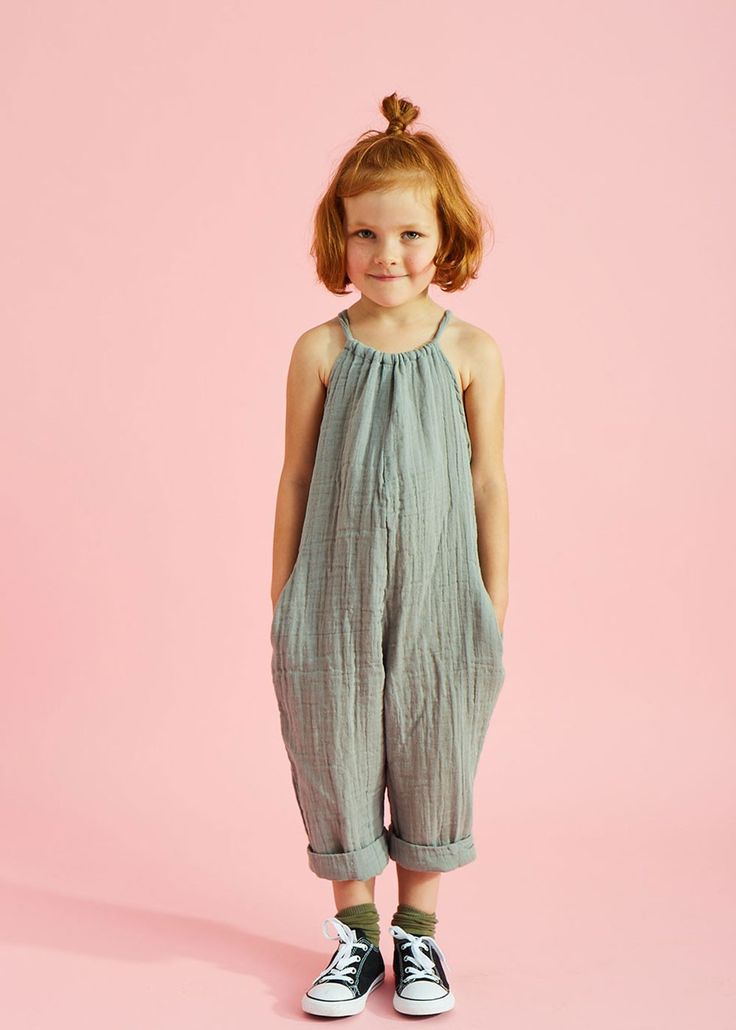 Casual cute toddler girl jumpsuit. The sneakers complete the outfit.