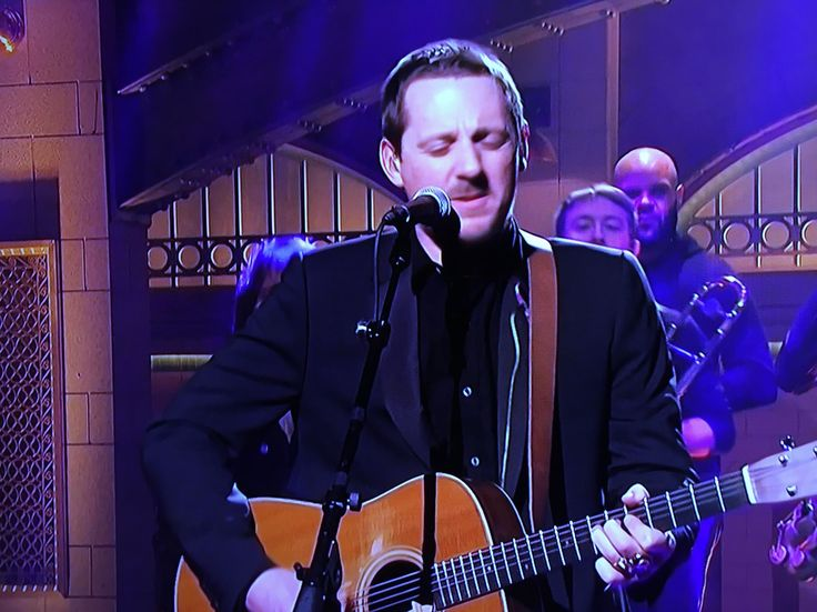 """Sturgill Simpson sang """"Keep It Between The Lines"""" on this week's """"SNL."""" The song is off his most recent album A Sailor's Guide To Earth. See the video below of Simpson's performance of """"Keep It Between The Lines"""" on """"Saturday Night Live."""" This marks Simpson's very first time as the musical guest on """"SNL."""" The country singer is on a roll. Two months ago, the 38-year-old Simpson was introduced to mainstream music fans when he received Grammy nominations for Best Country Album and Album Of The…"""