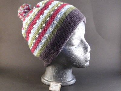 multistripe flat brim no ear flaps. 100% wool. Thrummed hat.