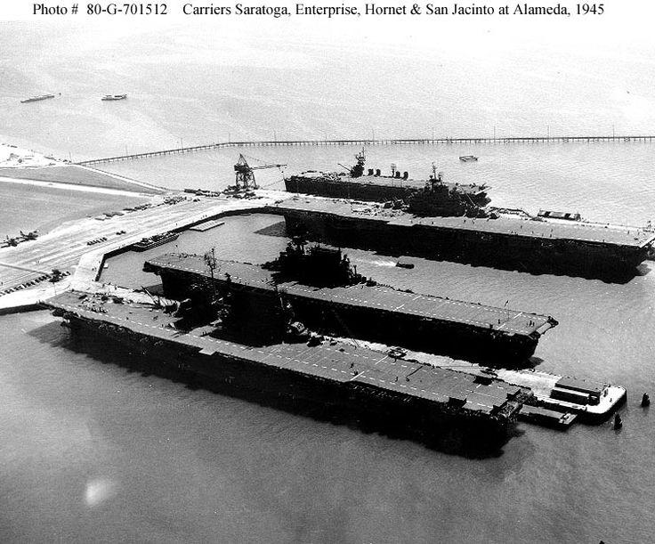 Naval Air Station Alameda Cal. Sept. 1943. Docked are-from front to back--Saratoga CV-3, Enterprise CV-6, Hornet CV12, and San Jacinto CVL-30.