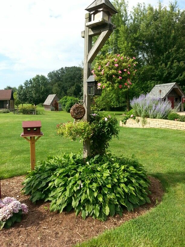 The side yard.. tom and debbie.. an old bird feeder.. new bird house...2013..please include this when pinning! thank you!