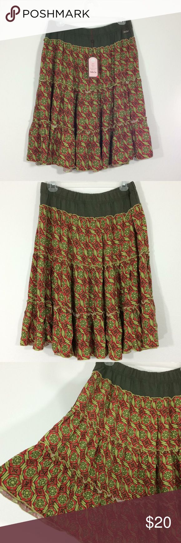 NWT Matilda Jane women's M tiered pattern skirt Absolutely lovely NWT Matilda Jane tiered skirt. Sz M Olive Waist with lime/orange/olive geometric pattern on full skirt. 100% Rayon. 100% comfort. Perfect with tank and sandals. Throw a shirt or jacket over for cooler nights. Ready for that summer concert/festival or seaside walk!🌸 Matilda Jane Skirts