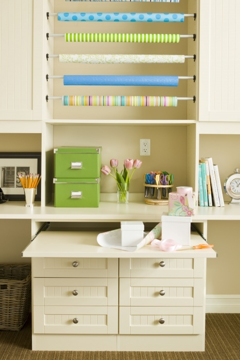 Create your own Gift Wrap Station. Mount tension rods to the inside of cabinets and slide your tubes onto the rods. Easy access gift wrap storage.
