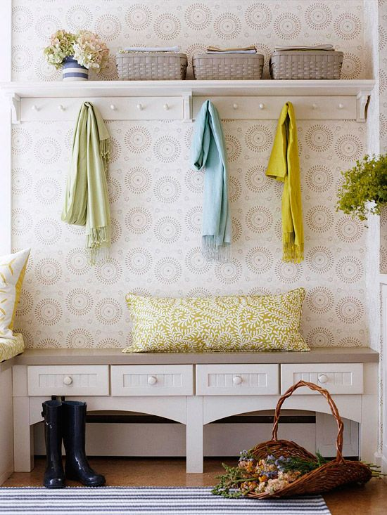 Beautiful wallpaper helps to bring a calm feel to this organised entryway, along…