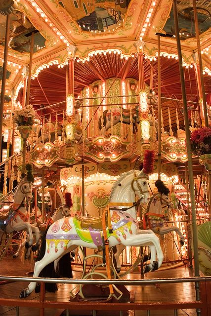 Morey's Pier Carousel, Wildwood NJ - A Venetian double decker carousel that features beautiful hand painted horses, swings, chariots and even spinning cups.