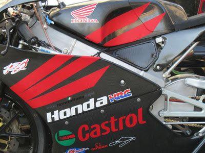 omega wrapping roma: Decorazione Honda HRC 125 in carbonio rosso