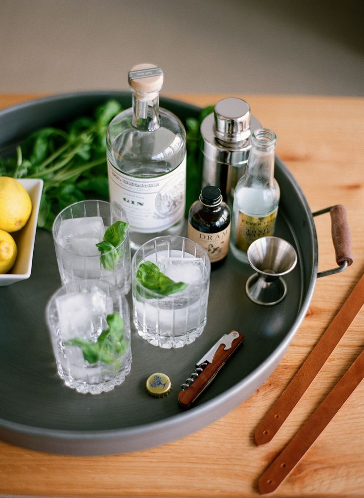 Gin and Tonics by Andover Trask Bag Company in Atlanta. St. George gin, Fever Tree tonic, Dram Apothecary bitters, and fresh basil. Photo by Buffy Dekmar Photography.