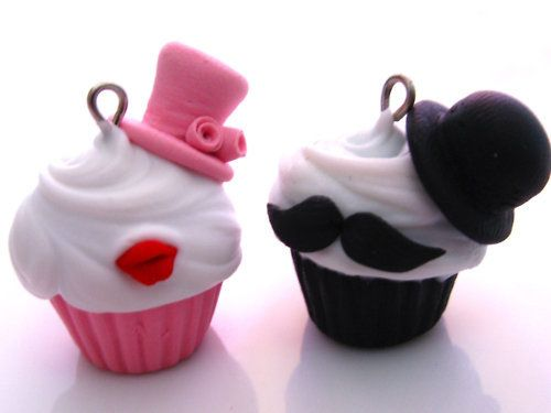 THESE ARE CHARMS BUT I WOULD LOVE TO MAKE ACTUAL CUPCAKES DECORATED LIKE THAT.
