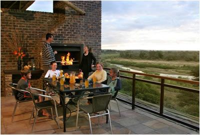 Ngwenya Lodge set in Kruger National Park. Watch the animals come to the riverside - all right from your balcony!