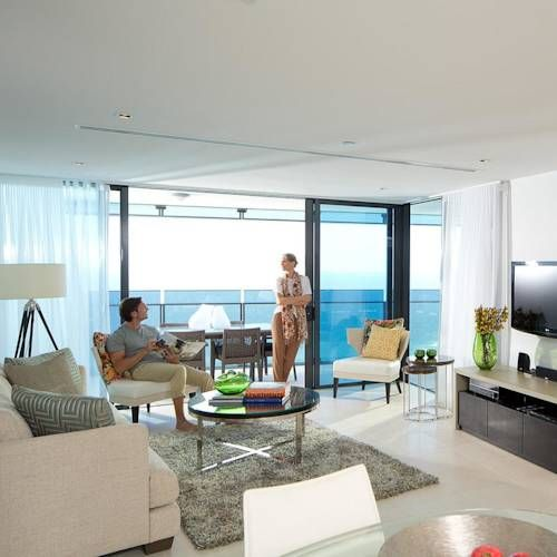 Surfers Paradise Beach #hotel in #Australia has one of the most breathtaking private balconies overlooking the ocean! Who wouldn't want to be relaxing in this gorgeous living room with such an incredible view of the #GoldCoast?