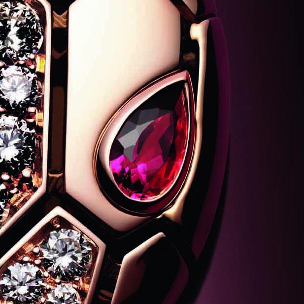 Bulgari Serpenti Seduttori pendant in rose gold, with two rubellite eyes and pavé set diamonds.