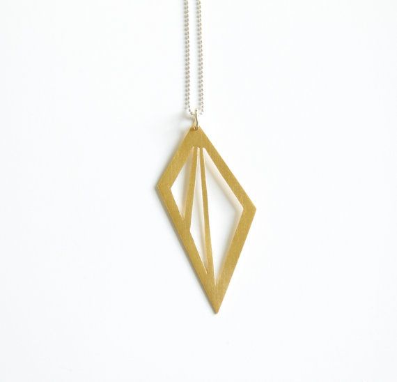 Cut-out gold geometric shape