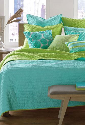 Adalae's room: she likes the reversible quilt (lime and torquoise) with white sheets
