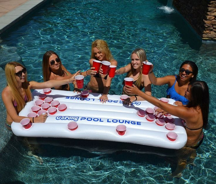 Pool Pong Lounge is a premium 6ft floating beer pong table with built in cup holders for Social Floating. This product is essentially a version of our popular Party Barge, but without the built-in cooler. The 6ft x 3ft table includes 10 cup triangles on each end for full size pool pong play. Each side of the raft is also lined with 4 cup holders for social floating, so you and your friends can float and socialize around the table between pong games. The Pool Lounge can also be used as a…