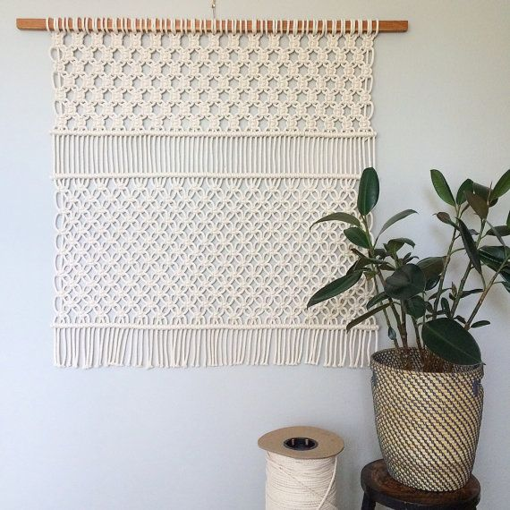 Handmade macrame wall hanging. Wood is solid cherry* and rope is 100% cotton.  Dowel width: 47 Weaving width: 39 Length: 41  *It will be made