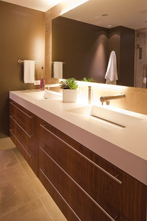 "kitchen & bath winner - complex and angular double vanity top in ""pure white"" designed by fritz jünker design + remodeling"