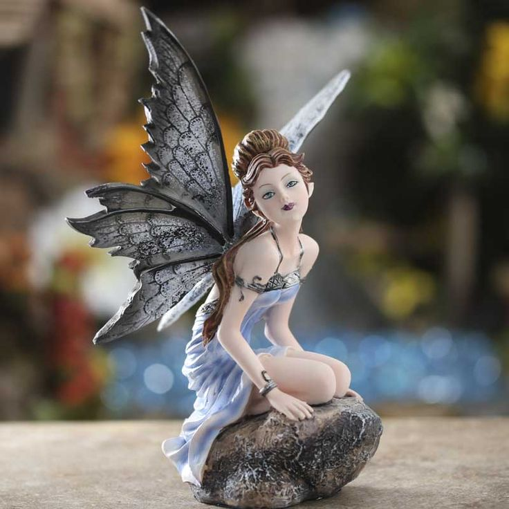 $19.99 Sitting Pensive Blue Fairy 3 1/4 inches long 5 inches wide 6 1/2 inches high Made of resin Suitable for indoor and outdoor use --BESIDE POND ON ROCK