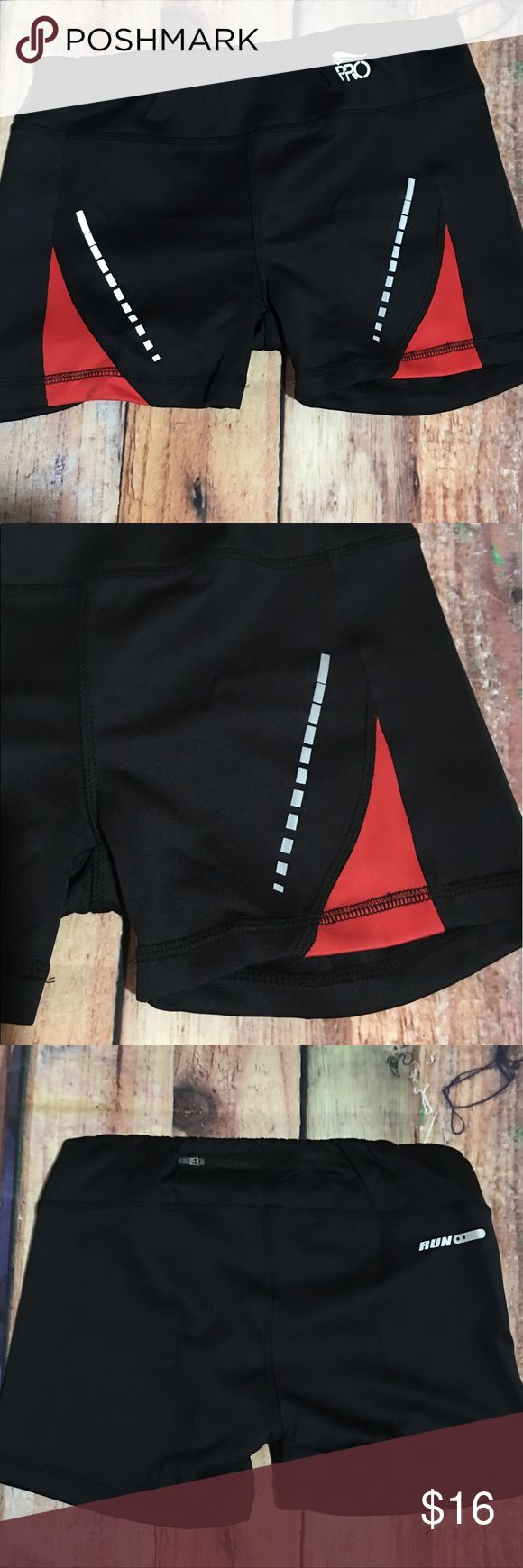 Crivit Pro Running Shorts Women's Small New Crivit Pro Running Shorts Women's Small 36-38 New With Tags msrp $24.99 Black with some red on sides and  silver reflector markings small zippered pocket on back waistband 86% polyester & 12% spandex rise 8 inches inseam 3 inches Crivit Pro Shorts