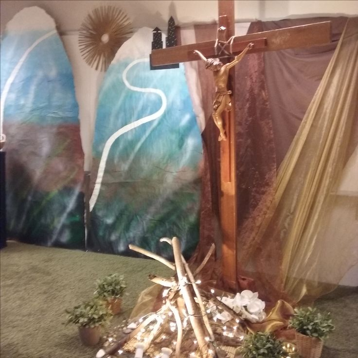 Mountains set design with faux campfire and straw sun.
