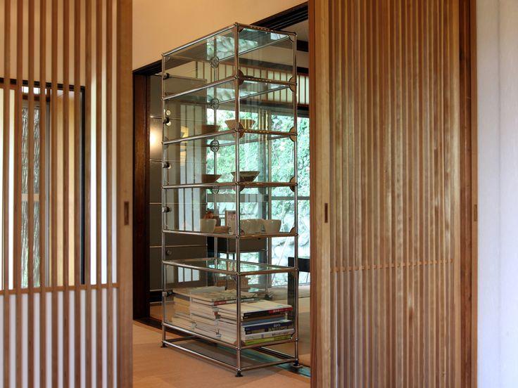 USM Haller glass shelving with hinges in chrome. www.usm.com