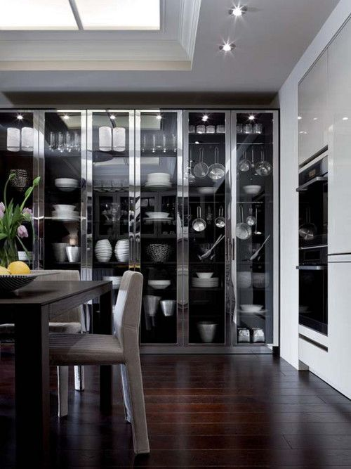 Floor-to-ceiling glass cabinets! Wouldn't use for the kitchen, but rather a living room for decor such as my shells!!!