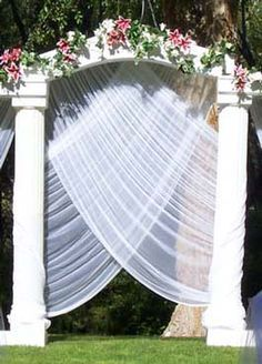 filmy draping. Could use a more solid fabric if wanting to use arch as a screen or backdrop. Tablecloths?