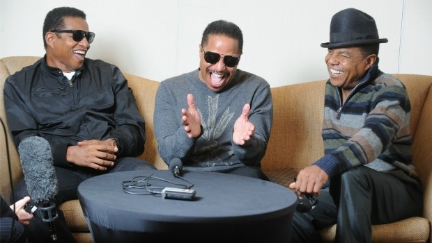 Jackie Jackson, Marlon Jackson, and Tito Jackson have a good laugh.