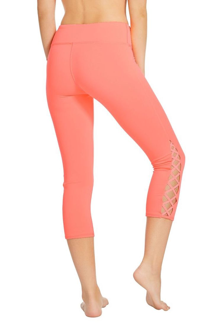 Try Fabletics today! Loving the cris-cross detail on these coral leggings. New twist on your favorite pair of workout leggings! Fabletics 2016.