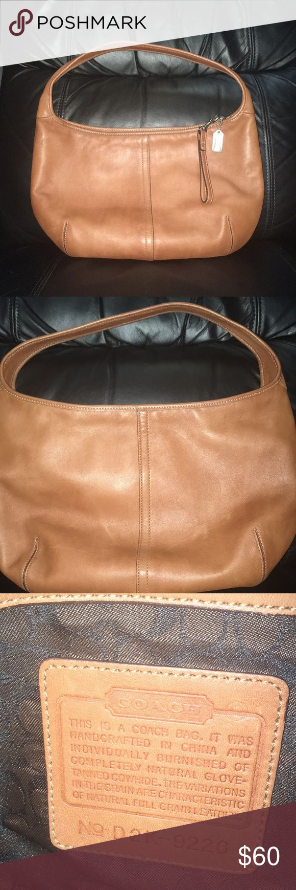 Gorgeous leather Coach hobo bag, camel color. It is in excellent used condition inside and out. The dimensions are approximately 13 x 9 x 3. Coach Bags Hobos