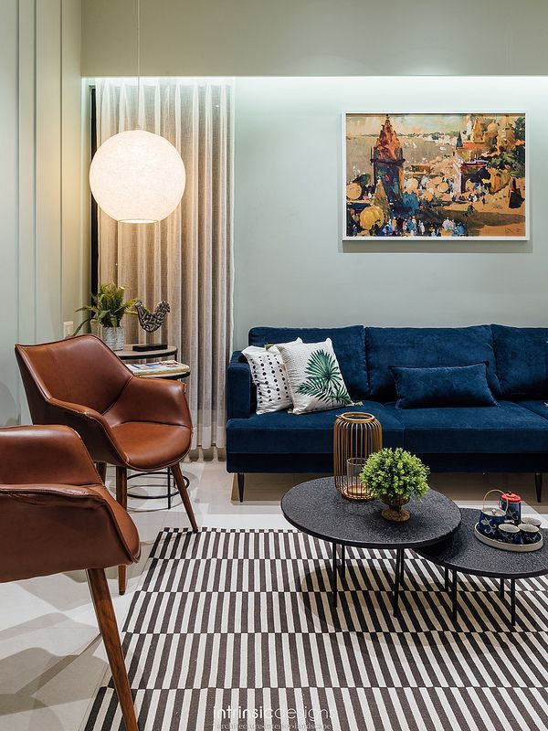 An Affordable Housing Apartment Gets A Highend Look Blue Couch Living Room Blue Sofa Living Blue Sofas Living Room
