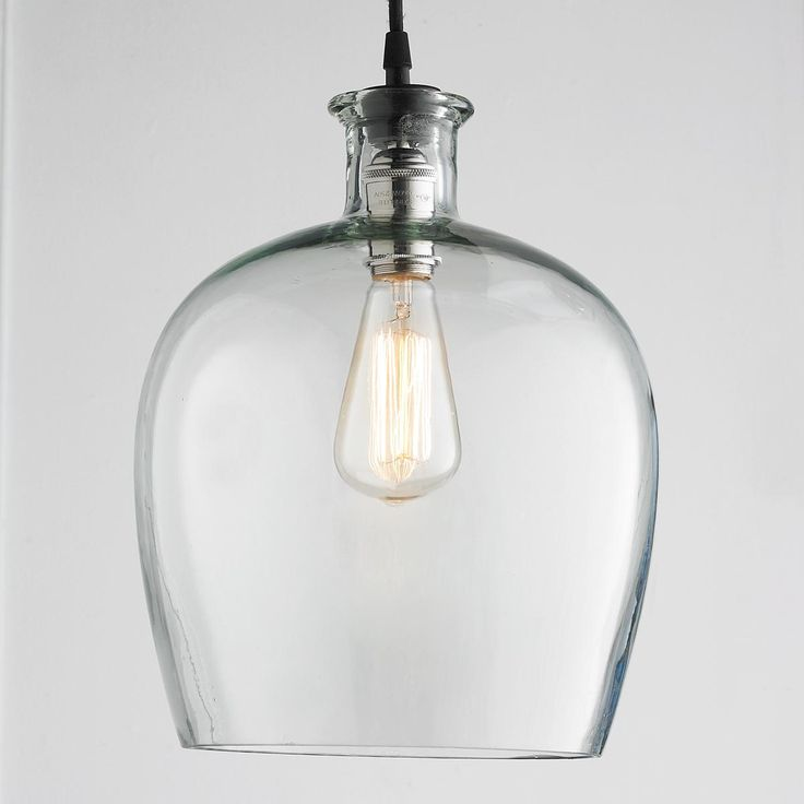 """Large Carafe Glass Pendant Light Clear the way for this graceful carafe shaped glass pendant light to add a real simple look to kitchens, bars, and hallways. Polished nickel restoration hardware and 9' black pendant cord. 75 watts medium base socket. (16""""Hx10""""W) 5"""" polished nickel canopy."""