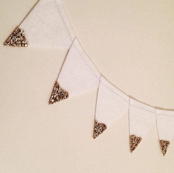 Gold and Silver Glitter Tipped Garland. This stunning white felt garland is machine stitched and finished with gold or silver glitter fabric