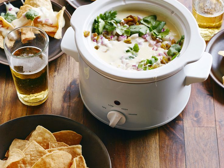 Queso Dip : This crowd-pleasing cheese dip is ultra-simple to make and easy to upgrade with toppings.