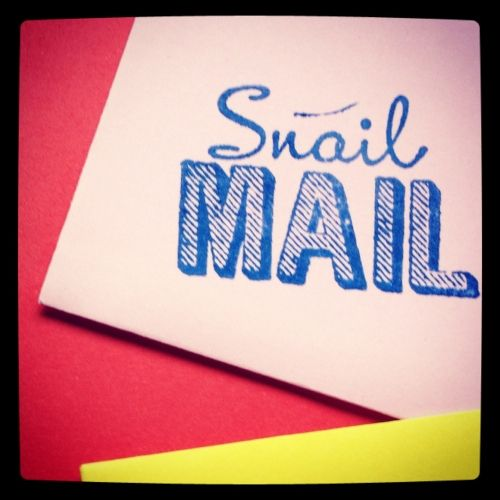 "Set of envelopes, hand stamped with the text ""Snail Mail""."
