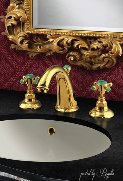 Gold and black with gold ornate mirror= elegant
